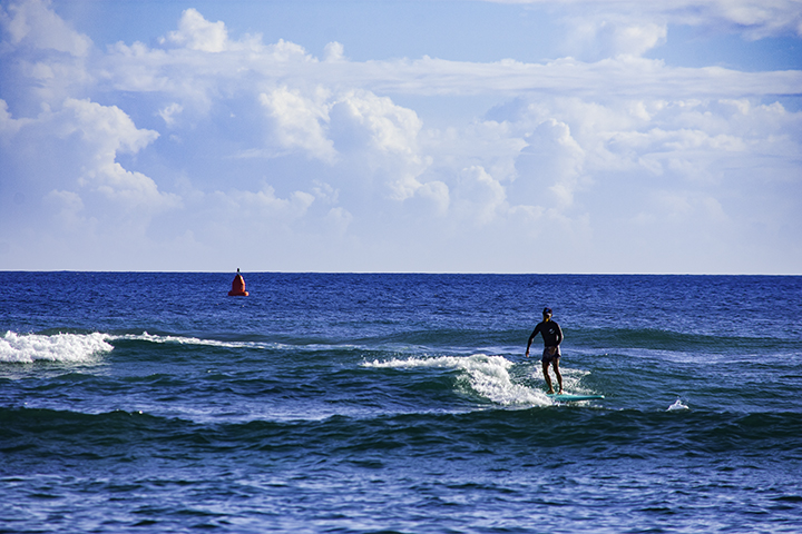 Surfing, one of the top things to do on Oahu.